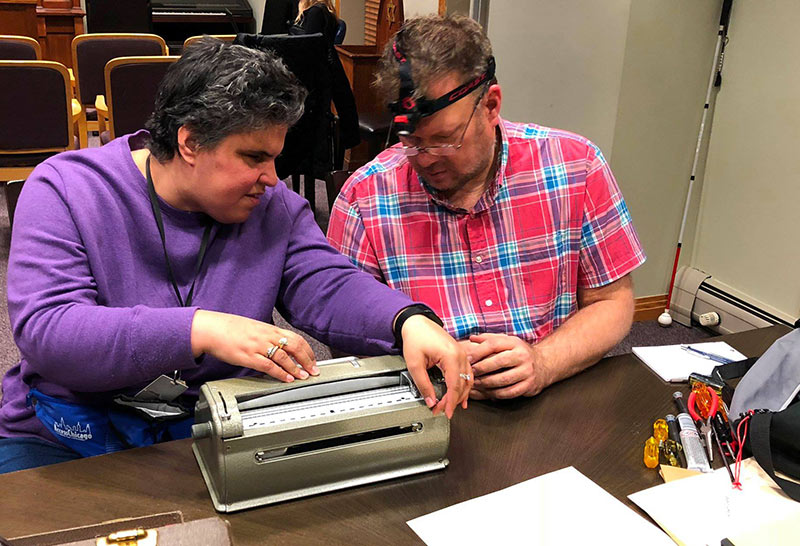 2 residents with braille writers