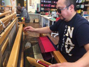 Weaver at loom