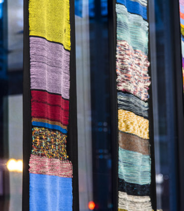 Woven Tapestries hanging in a window