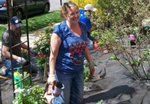 Rita helps landscape the grounds of Friedman Place with volunteers and staff.