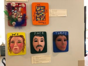 "Three mixed-media pieces by Friedman Place residents. The works, cited clockwise, are ""Untitled,"" ""We Are Strong Together,"" and ""We Face Today"""