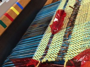 "A woven tapestry, part of the collaboration between Julia Miller and residents, ""Blind Weavers Explore Sound"""