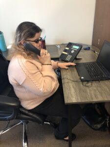 Adnana, Friedman Place's Navigator, working with a client over the phone